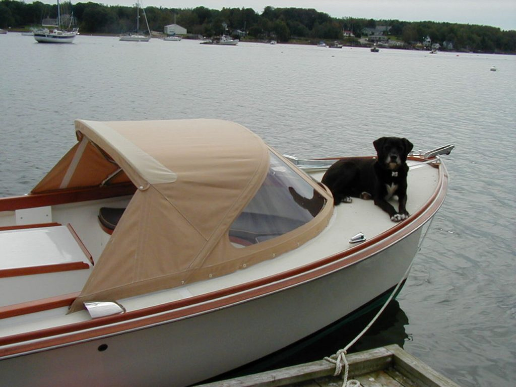 Drop top dodger on a picnic boat with Deke