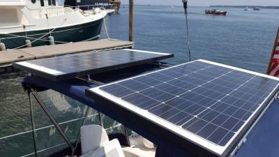 Twin rigid solar panel attached with Gemini Marine Products.
