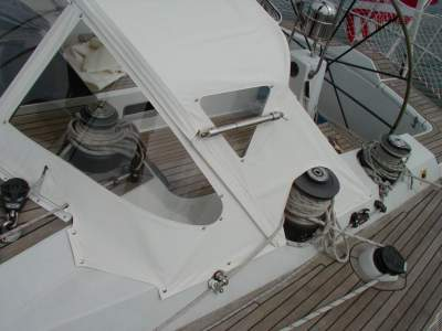 White drop top dodger on sailboat.
