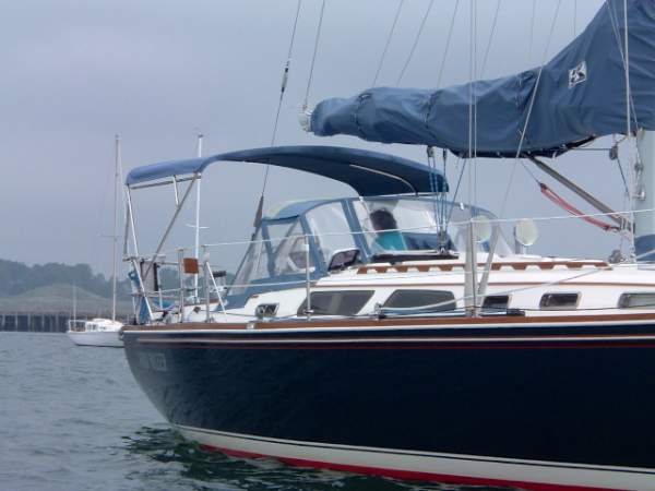 Large strapless bimini top on a sailboat.